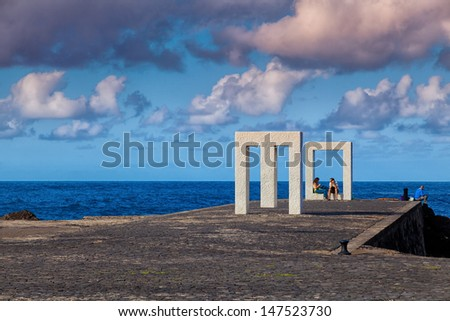 GARACHICO, SPAIN - NOVEMBER 18: People resting in Tensei Tenmoku Sculpture, made by Kan Yasuda, specialist in the work of marble on November 18, 2012 in Garachico, Tenerife, Spain #147523730