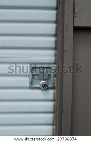 garage door at a self storage facility with a padlock on it