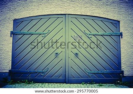 Garage door in retro vintage colors. Double sided doors of modern garage in a building.