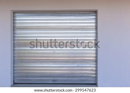 Garage Door Metal\ New installed sheet metal garage door into building.