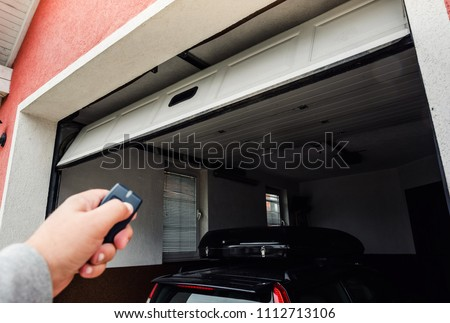 Garage door PVC. Hand use remote controller for closing and opening garage door.  #1112713106
