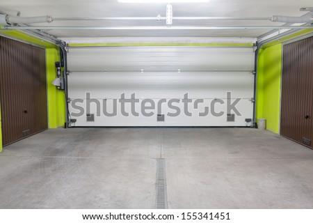 Garage door. Underground garage located under modern house estate block of flats