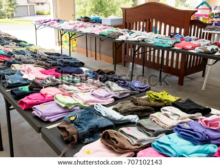 Garage sale tables with clothing #707102143