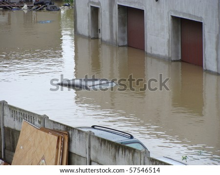 garages and cars drowned by the floods