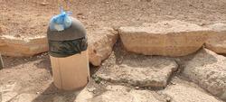 Garbage can full of trash found in a clean park in a Park in Diplomatic Quater, Riyadh Saudi Arabia.