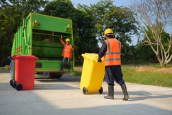 Garbage collector Worker of urban municipal recycling garbage collector truck loading waste and trash bin