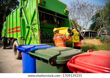 Garbage collector Worker of urban municipal recycling garbage collector truck loading waste and trash bin Сток-фото ©