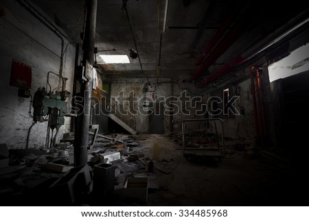 garbage, dirty room in an abandoned old factory, poor light