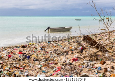 Garbage dump, landfill on Micronesian atoll sand beach, South Tarawa, Kiribati, Oceania, South Pacific Ocean. Ecological and garbage management problems of island nations. Pollution and global warming