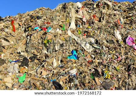 Garbage dump with construction waste. Trash disposal and food waste. Recycling of waste at junk yard. Dispose the rubbish in landfill. Trash disposal and rubbish dump with polution. Ecology concept