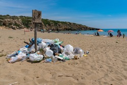 garbage in calamosche beach probably the more beautiful in Italy