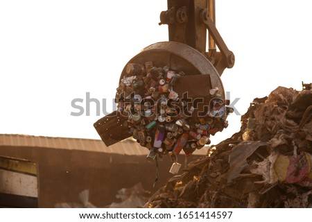 garbage isolated on the white background,Backhoe use electromagnets crane, magnet cranes are recycling metal, waste disposal industry,Greenhouse effect