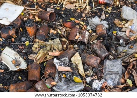 Garbage, metal, cans, glass bottles, tiles that are difficult to remove or decompose. And toxic to the environment.  #1053074732