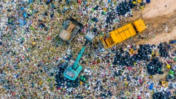Garbage pile in trash dump or junkyard, Aerial view garbage metal truck unload garbage consumption junkyard scarp, Global warming, Ecosystem and healthy environment concepts and background.