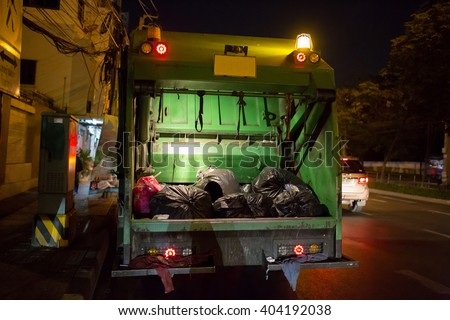 Garbage Truck On A Night Shift