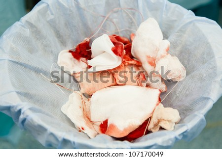 garbage with blood at surgery. image wit shallow DOF