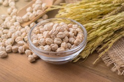 Garbanzo beans or chickpeas in a glass bowl and spread on the floor with copy space.
