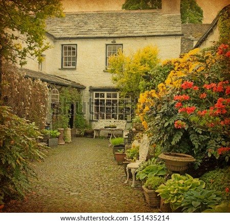 garden at the front of  old house, Lake District, Cumbria, UK.  Photo in retro style. Paper texture. Foto d'archivio ©