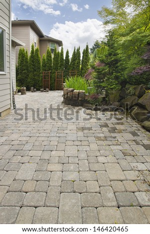 Garden Backyard Hardscape Brick Pavers Patio With Pond Trees Natural Rocks Landscaping