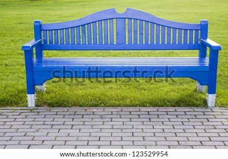 Garden bench on green grass background - stock photo