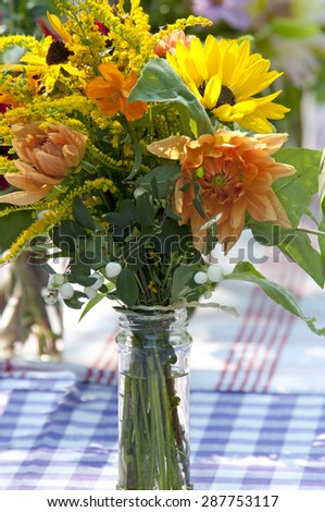 garden bouquet with Dahlia\'s on garden table, The Netherlands