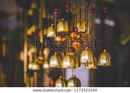 Garden decoration, wind chimes hanging in a blooming tree, bamboo chimes on a cherry tree in garden
