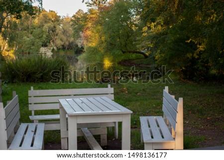 Garden furniture near the house near the lake in the autumn day #1498136177