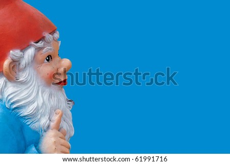 garden gnome with a wagging finger isolated on blue