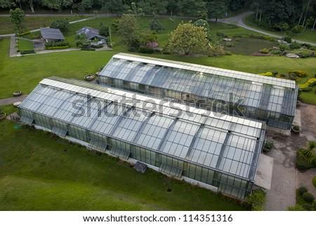 Garden greenhouse and the garden outside. #114351316