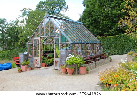 garden greenhouse with cold frame and pots
