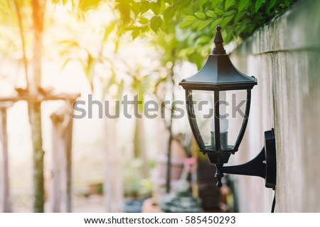 Garden Lanterns on the Wall with Sunlight Background for Home Decorate Idea #585450293