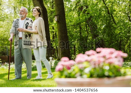 Garden of the nursing home and nurse with patient