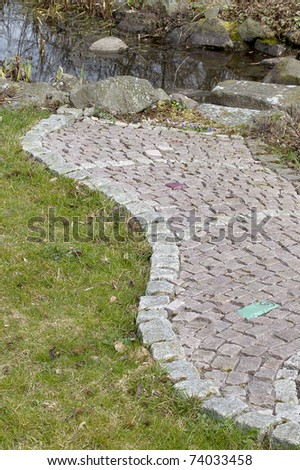 garden path with small stones. With some colored stones for decorative reason