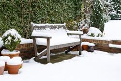 Garden patio bench with snow