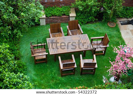 Garden patio with table and chairs after raining