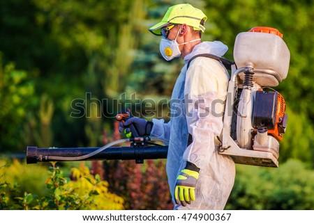 Garden Pest Control Services. Men with Gasoline Pest Control Spraying Equipment. Professional Gardening