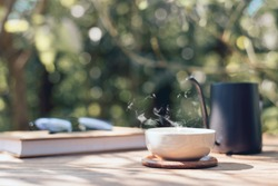 Garden reading table, Teacup placed on wooden table, Close-up