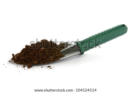 garden spade with soil over a white background - stock photo