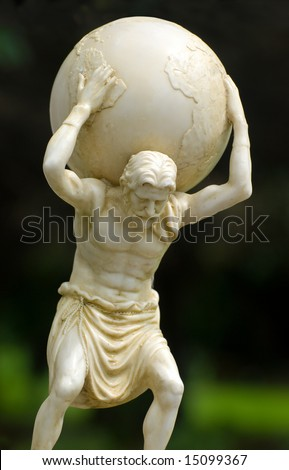 Garden statue of Atlas holding the world on his shoulders