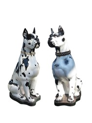 Garden statue of two dogs isolated over white background