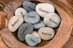 Garden Stones, Rocks with Motivational Words Inscribed on them, Love, Happiness, Believe, Harmony, Courage, Create.