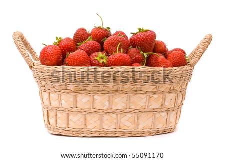 Garden Strawberries in wooden basket isolated on white