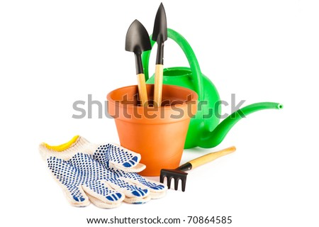 Garden tools, clay flower pot and gloves isolated on white background