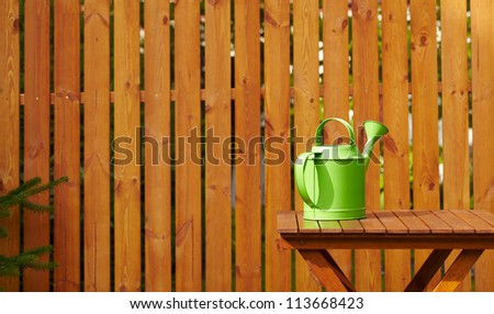 Garden tools on the wooden background