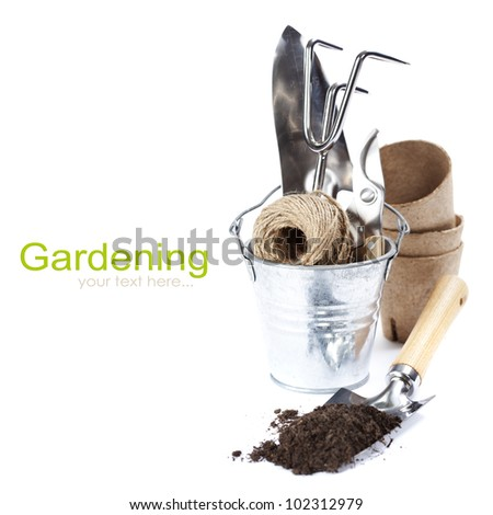 garden tools (shovel,  rake, pruner, garden string and peat pots ) over white (with easy removable text) - stock photo