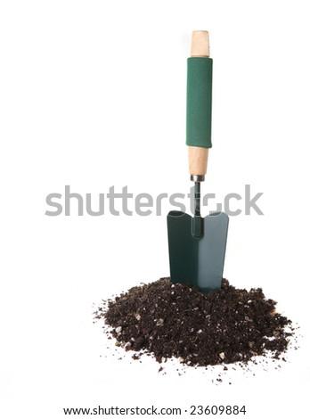 Garden Trowel Tool Standing Upright in Potting Soil