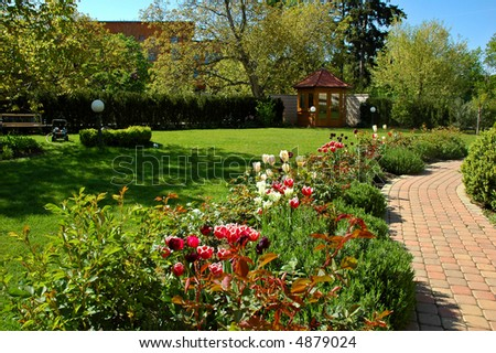 Garden with tulips, gazebo and path
