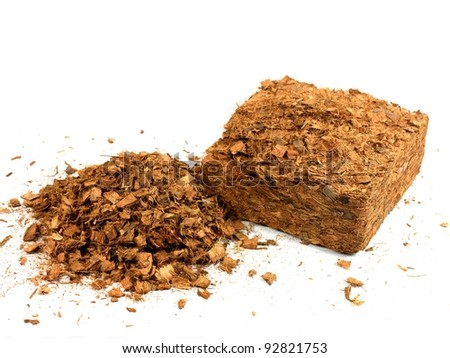 Garden wood chip mulch isolated against a white background