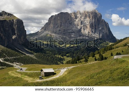 Gardena valley and Sassolungo (Langkofel) in the background, Dolomites, South Tyrol, Italy.