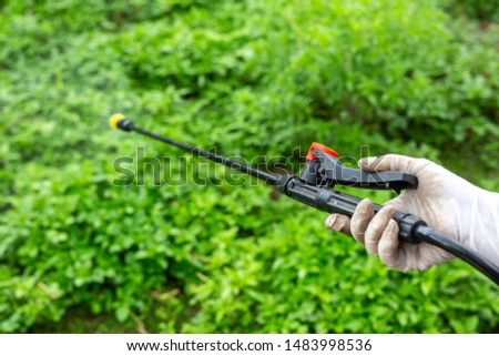 Gardeners are spraying wrist cuffs at close range. #1483998536